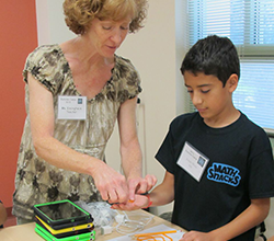 Teacher helping with hands-on activity